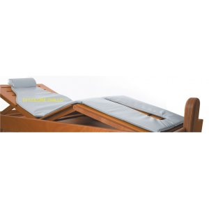 Replacement yellow latex mattress and pillow headrest for steam bed.